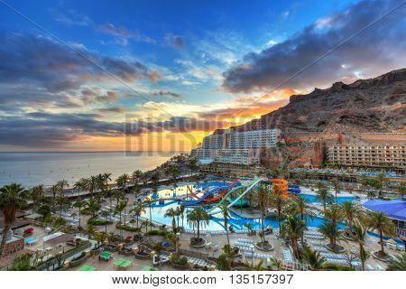 Atlantic beach of Gran Canaria island in Taurito at sunset, Spain