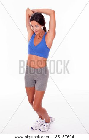 Stretching Brunette Woman On White Backgound