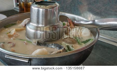 Sour And Spicy Seafood Soup In Hot Bowl