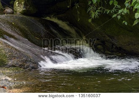 River running through the rocks and the rain forest of the national park of Itatiaia
