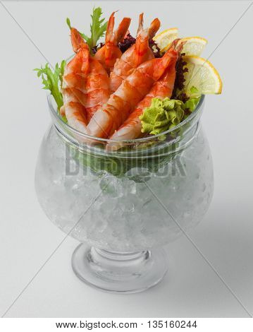 Shrimp Salad With Wasabi, Lemon And Greens In A Bowl With Ice On A White Background