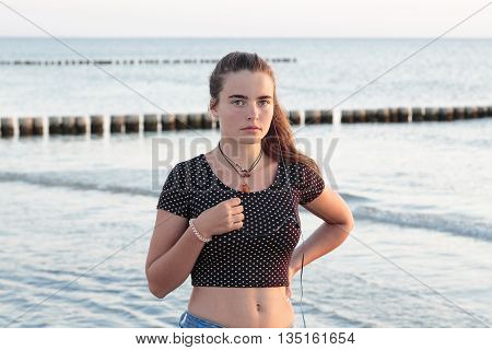 Portrait Of A Woman With Earphones At The Ocean