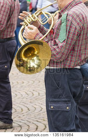 Man Playing The Horn In A Military Band