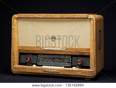 Old vintage radio on a dark background