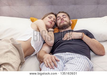 Young Couple In Love Is Sleeping Again In The Morning
