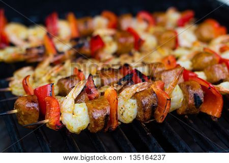 spicy cajun shrimp and sausage skewer on the bbq grill