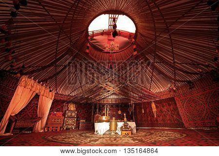 TURKESTAN, KAZAKHSTAN - AUGUST 29, 2015: Interior of a nomadic tent known as yurt.