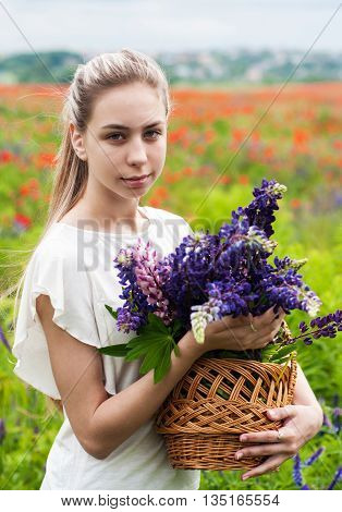 Girl With Basket Of Lupine Flowers
