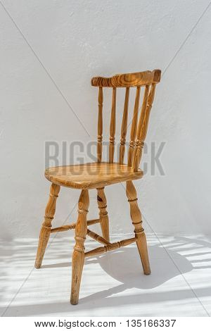 Vintage old wooden chair. On a white background.