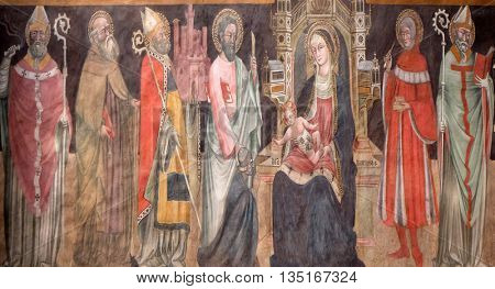 BOLOGNA, ITALY - JUNE 04: Virgin Mary with baby Jesus and saints, fresco in San Petronio Basilica in Bologna, Italy, on June 04, 2015