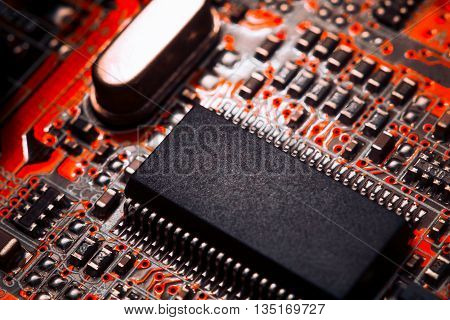 Bokeh electronic circuit close up computer in red colors