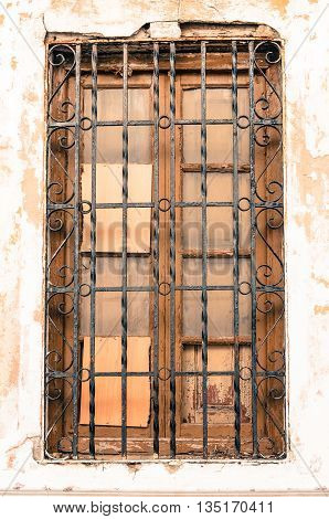 Brown Wooden Window With Metal Grille In Vintage Style