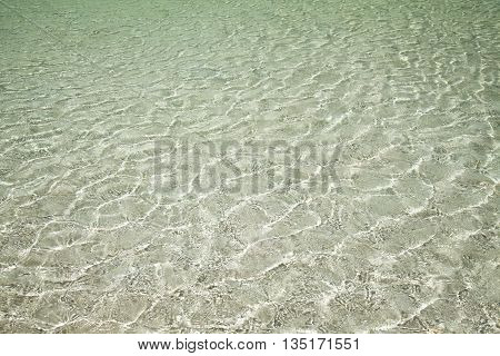 Shallow Water Over White Sand