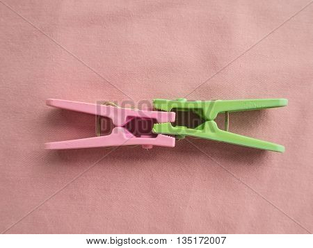 clothes peg on the fabric pink color