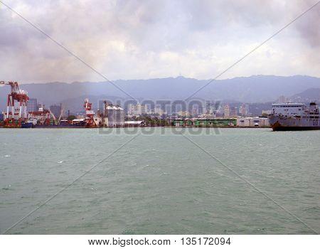 CEBU CITY, CEBU / PHILIPPINES - JULY 30, 2011: A view of Cebu City, as seen from a passenger ferry leaving the island.