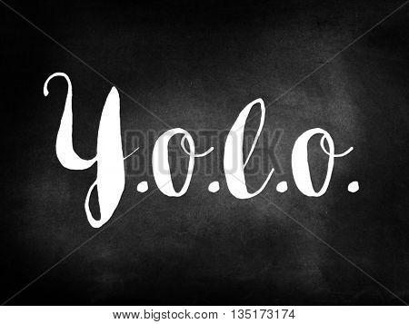 Yolo written on a chalkboard