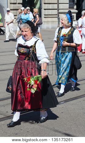 ZURICH - AUGUST 1: Swiss National Day parade on August 1, 2009 in Zurich, Switzerland. Woman in a historical costume.