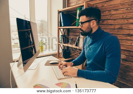 Confident Serious Man Working In Office On Computer And Typing