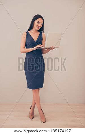 Portrait Of Cheerful Smiling Successful Businesswoman Holding Laptop