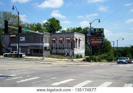 JOLIET, ILLINOIS / UNITED STATES - JUNE 3, 2015: The building that once housed the Artistic Signs business is vacant and for sale.