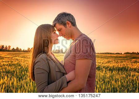 deep sunset in a field with man and girl