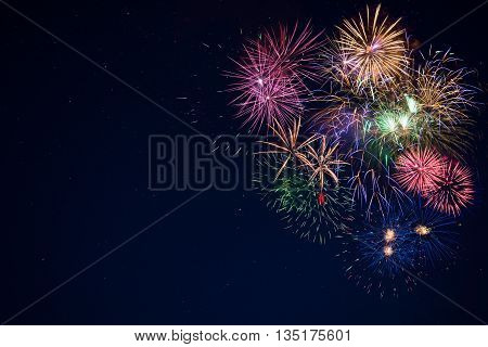Beautiful celebration golden red purple green sparkling fireworks. New Year beautiful fireworks. Holidays symbol background. Independence Day 4th of July holidays salute.