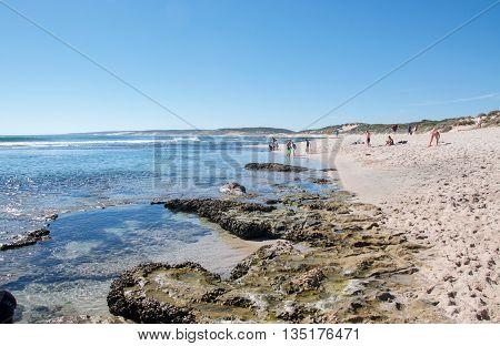 KALBARRI,WA,AUSTRALIA-APRIL 21,2016: Tourists at the Blue Holes beach with fringe reef, rock pools and Indian Ocean waters on the coral coast of Kalbarri, Western Australia.