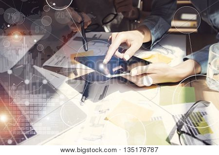 Photo Girl Touching Screen Electronic Tablet Hand.Project Manager Researching Process.Business Team Working Startup modern Office.Digital Connections world wide interfaces.Analyze market stock.Blurred