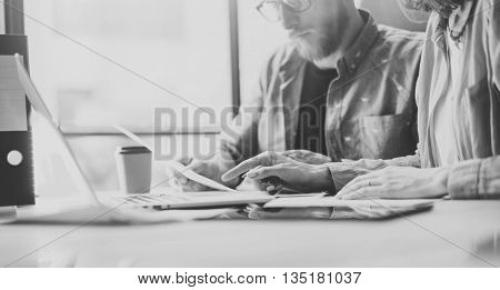 Sales Department Working Modern Design Loft.Woman Showing Market Report Charts Laptop.Marketing managers Planning New Strategy.Researching Process Wood Table.Horizontal.Blurred Background.Black White