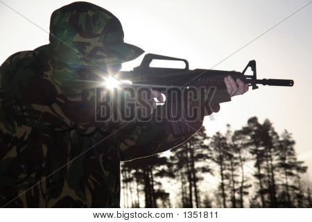 Soldier, His Rifle And The Sun