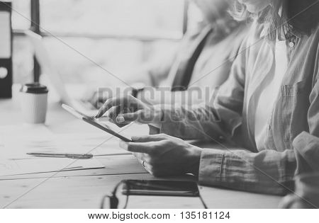 Coworkers Team Researching Process in Modern Desing Studio.Project Producer Work.Female Holding Tablet hand.Young Business Crew Working New Startup.Risk Management Process.Black White