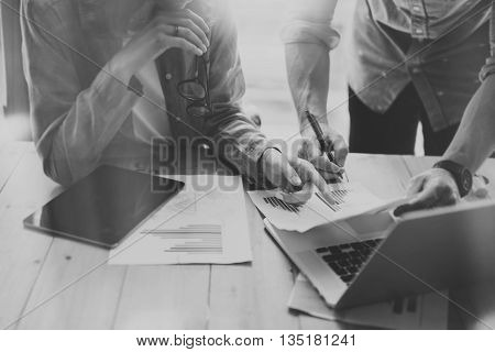 Sales Managers Working Modern Studio.Woman Showing Market Report charts.Marketing Department Planning New Strategy, using Digital devices.Researching Process Wood Table.Horizontal.Blurred, black white.