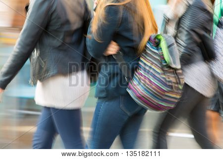 LONDON, UK - OCTOBER 4, 2015: People, tourists and Londoners walking via Leicester square, the famous destination of London for night life, cinemas, restaurants and bars