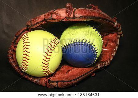 Closeup of a Softball Glove and match ball