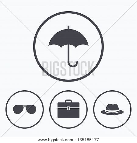 Clothing accessories icons. Umbrella and sunglasses signs. Headdress hat with business case symbols. Icons in circles.