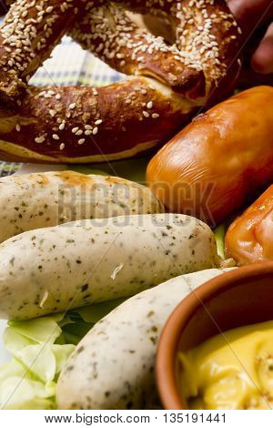 Traditional German sausages and mustard cabbage leaves