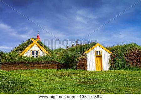 The village of ancestors in Iceland. The recreated village -  museum of pioneers - Vikings. Houses are roofed by the turf