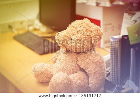 teddy bears sitting on the desk with vintage tone