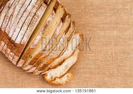 Burlap Tablecloth Under Sliced Artisan Bread
