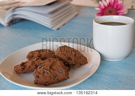 Chocolate Chip Cookies On Blue Table Background