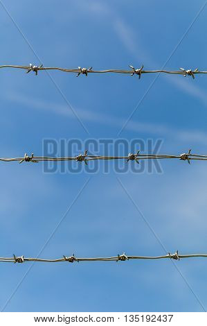 fence with barbed wire to shut off