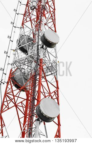 Satellite dish telecoms on telecommunications tower on white clear sky