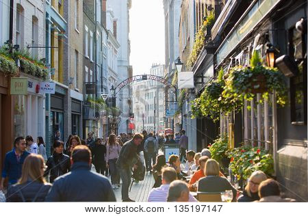 LONDON, UK - OCTOBER 4, 2015: Kingly street with cafes and restaurants and lots of walking people, tourists