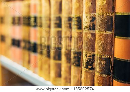 Aged Ancient Antique  Old Vintage Books On A Shelf In Library