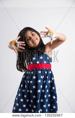 cute girl showing her colorful hands, surprised. Indian young girl with palm painted, asian girl and palm painting, palm printing
