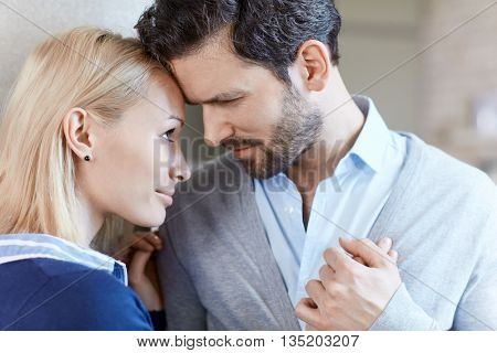 Closeup portrait of loving couple hugging, tender moments.
