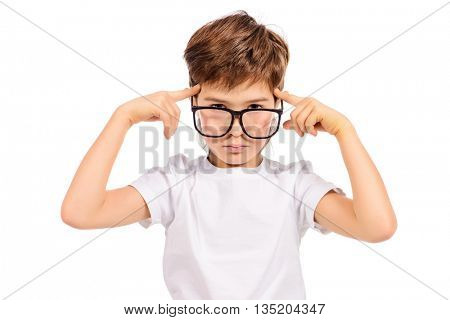 Thoughtful smart boy wearing big glasses. Education. Optics. Studio shot. Isolated over white.