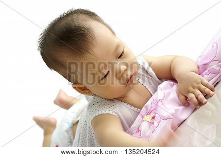 Cute baby lying on the floor. Little infant lying on purple bed.