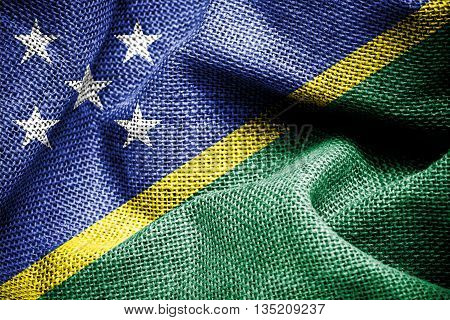 Texture of sackcloth with the image of Solomon islands flag