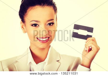 Businesswoman holding a card.